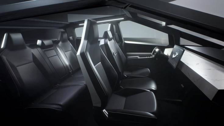 The Cybertruck, as revealed, can seat up to six adults. The cabin is pure Tesla: total minimalism, with the dashboard dominated by a 17-inch tablet-style touchscreen.