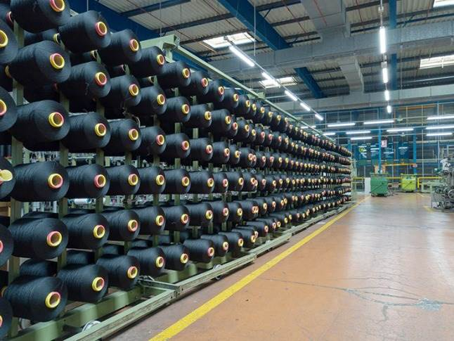 Adient Fabrics receives the reconstituted yarn on reels at its Laroque d
