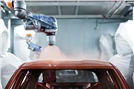 Craftsmanship joins forces with robots at Nissan for two-tone painting