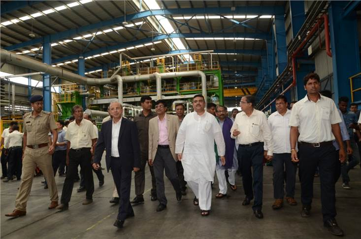 West Bengal's minister for Transport and Environment and chairman, Haldia Development Authority, Suvendu Adhikari and Gautam Chatterjee, MD and CEO, Exide Industries with other  delegates at the plant