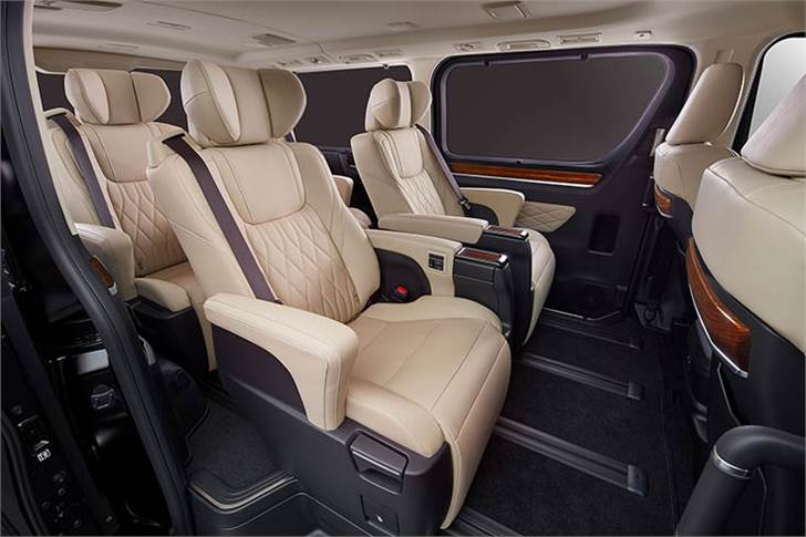 Wood grain finish flows from the back of the front seats toward the side trim as if to wrap rear seat passengers in comfort.