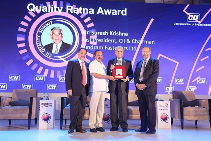 D V Sadananda Gowda, Minister of Chemicals and Fertilizers, government of India presents the 'Quality Ratna' award to Suresh Krishna, chairman, Sundram Fasteners. Also seen are (extreme left) Vikram Kirloskar, president, CII & vice- chairman, Toyota Kirloskar Motor and (extreme right) R. Mukundan, chairman, CII Institute of Quality and MD, Tata Chemicals.