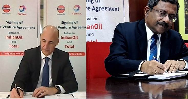 PatrickPouyanné, Chairman andCEOof Total and ShrikantMadhavVaidya,chairmanofIndian Oilsign the joint venture pact.