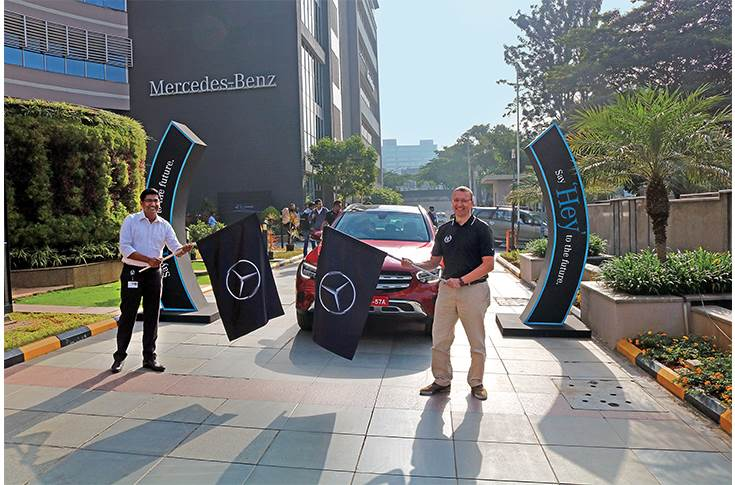 Martin Schwenk, MD and CEO, Mercedes- Benz India and Manu Saale flagging off a GLC media drive event last December.