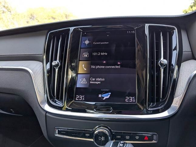 Nine inch portrait-oriented touchscreen infotainment screen powered by Volvo