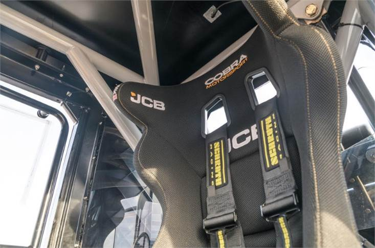 FIA-approved Cobra motorsport seat is straight racing-car specification and fitted with a five-point racing harness. Even with a helmet on, though, there's ample head room beneath the roll-cage.