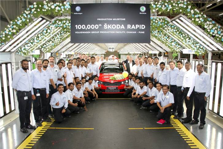 Gurpratap Boparai, MD, Volkswagen India and Zac Hollis, director - sales and marketing, Skoda Auto India at 100,000th Rapid production.