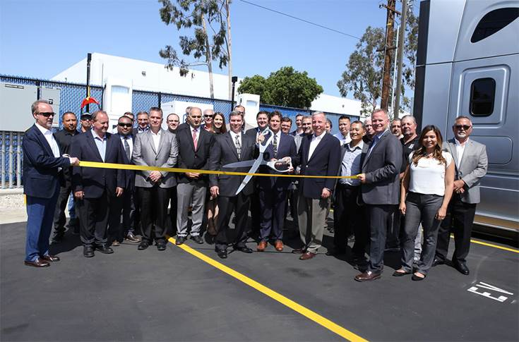 Penske celebrating the announcement of its new electric vehicle commercial charging capabilities at its La Mirada, CA, facility during a livestream ribbon-cutting event with the Advanced Clean Transpo