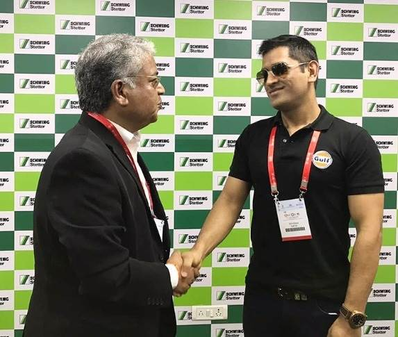 Cricketer M S Dhoni at the Schwing Stetter stall. Seen here with V G Sakthikumar, Managing Director, Schwing Stetter India.
