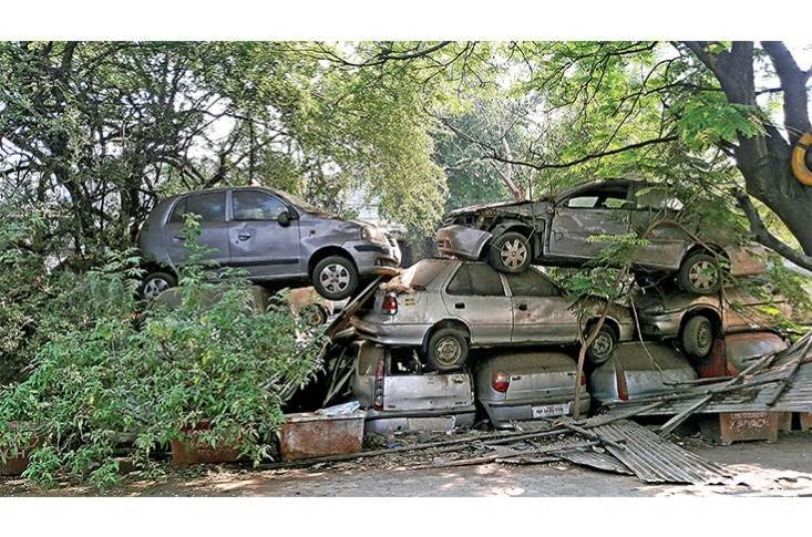 Vehicle graveyard in Delhi. Current scrappage practices compromise safety and security. The fluids from cars are drained on the street, and practices like gas cutting result in severe health issues to