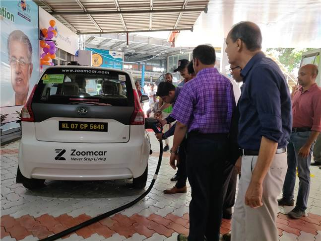 District Collector Ernakulam S Suhas charges an EV at Kerala