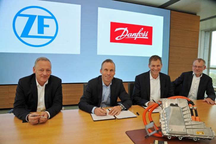 Harald Deiss, Head of ZF Business Unit Electronic Systems; Jorg Grotendorst, Head of ZF Division E-Mobility; Kim Fausing, CEO, Danfoss Group; and Claus A. Petersen, Head of Danfoss Silicon Power.