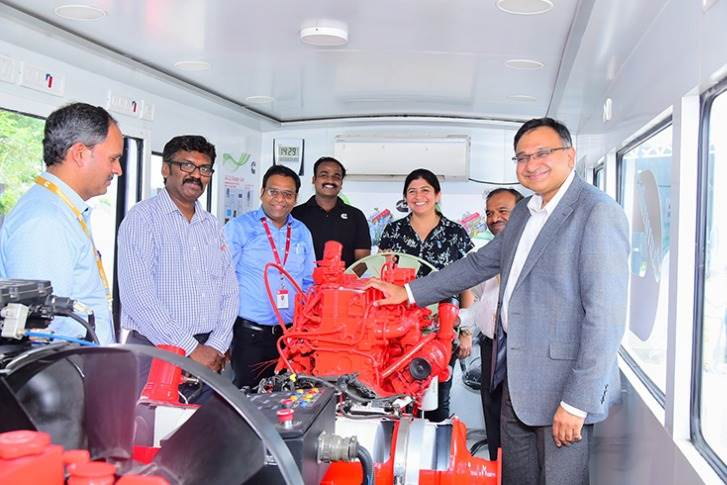 R-L: Ashwath Ram, MD, Cummins India; Anjali Pandey, VP (Engine Business and Component Business), Cummins India and a team of service engineers inside the training van.