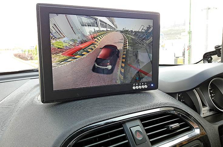 LCD screen mounted on the dashboard provides surround view including over-the-top visual of the vehicle.