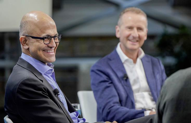 Satya Nadella, CEO of Microsoft (middle) with Dr. Herbert Diess, CEO of Volkswagen AG (right)