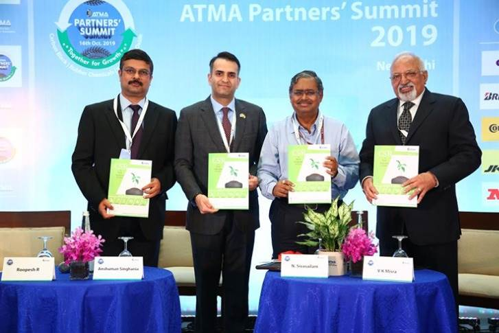 L-R: Roopesh R(Convener, ATMA SCR Group), Anshuman Singhania (Vice-Chairman, ATMA), N. Sivasailam (Special Secretary - Logistics GOI), and V K Misra(Chairman ITTAC) releasing the CSR Compendium.