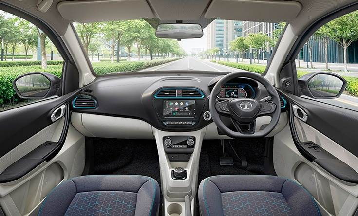 The Tigor EV gets a 7.0-inch touch-screen infotainment system with Apple CarPlay and Android Auto, 4 speakers and 4 tweeters, iRA connected car tech, multi-function steering wheel, automatic climate control, digital instrument cluster, and much more.