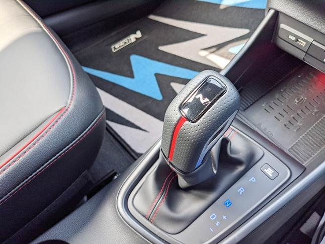 Gear shift selector also gets N embellishments to sync with the cabin theme.