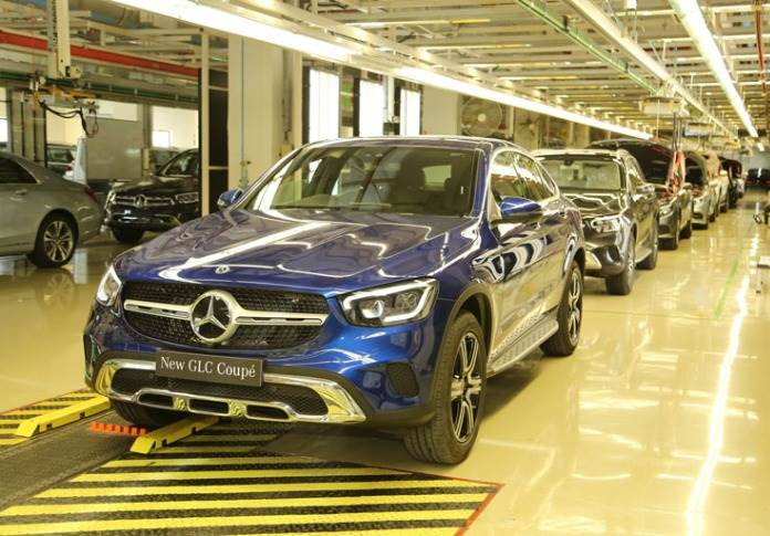 A new Mercedes-Benz GLC Coupé rolls out of the assembly line at Mercedes-Benz India's Chakan plant near Pune.