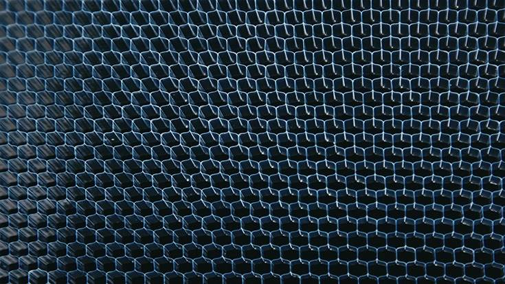 Nissan's acoustic meta-material is one-fourth the weight of heavy rubber board yet provides the same degree of sound isolation.