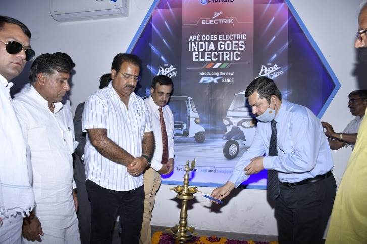 Pratap Singh Khachariyawas, Transport Minister of the Rajasthan government along with other dignitaries lighting the lamp at the Piaggio EV Experience Center in Jaipur, Rajasthan.