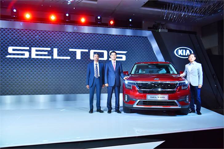 L-R: Manohar Bhat, VP & Head - Sales & Marketing; Kookhyun Shim, MD & CEO, Kia Motors India; and Yong S Kim, Executive Director & CSO, at the launch of the Kia Seltos.