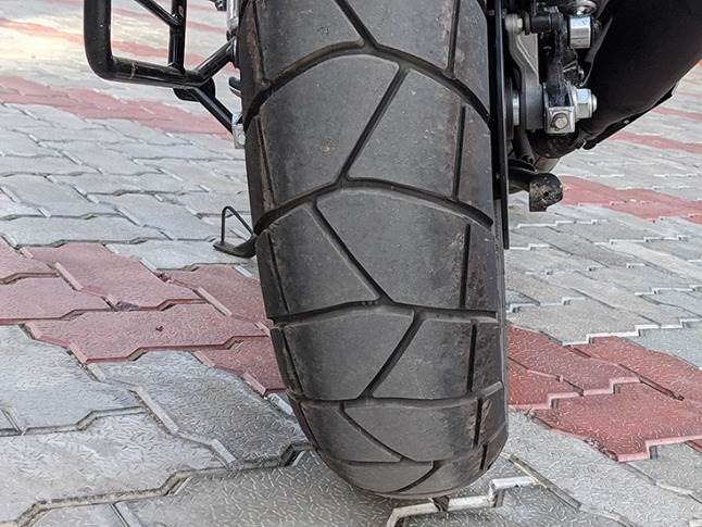 Beefier 150mm MRF rear tyre looks rugged while aiding high-speed stability.