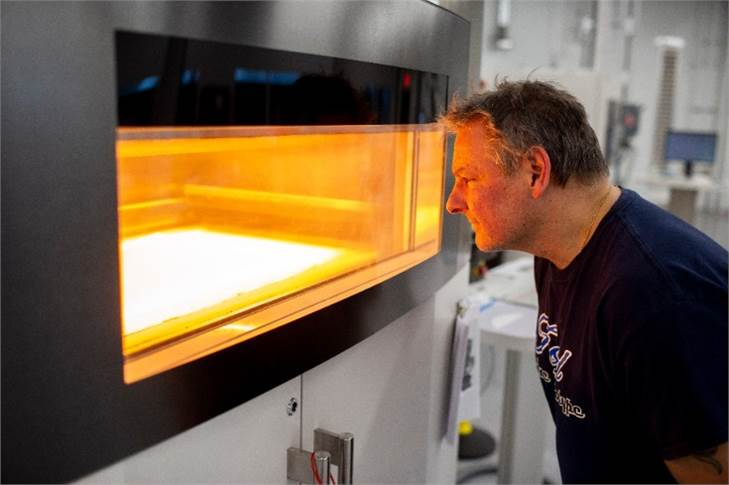 Dave Jacek, additive manufacturing technician, oversees production of 3D-printed disposable respirator mask prototypes at Ford's Advanced Manufacturing Center.