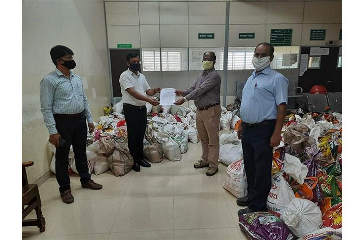 Piaggio team handing over ration kits to Executive Magistrate's  Office, Baramati.