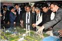 The minister and the dignitaries at one of the 750 exhibitions at Petrotech 2019