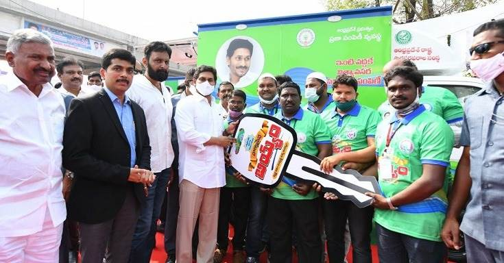 YS Jagan Mohan Reddy, chief minister, Andhra Pradesh handing over the keys to the mobile vans to beneficiaries under the Employment Guarantee Scheme.