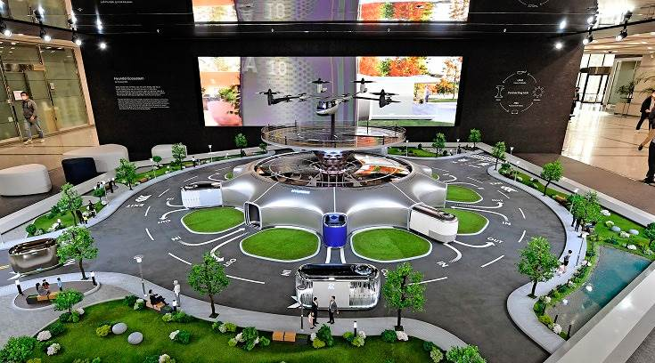 The 1:8-scale model on display is a miniature of the exhibit shown at CES 2020 and includes integration of its Urban Air Mobility (UAM), Purpose Built Vehicles (PBV) and Hub (Mobility Transit Base) smart mobility solutions as part of a dynamic human-centered future cityscape.