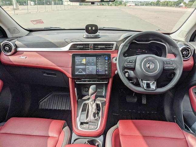 Astor gets a premium interior with multiple colour options and generous use of soft-touch materials. AI assistant robot placed atop dashboard is a first in segment.