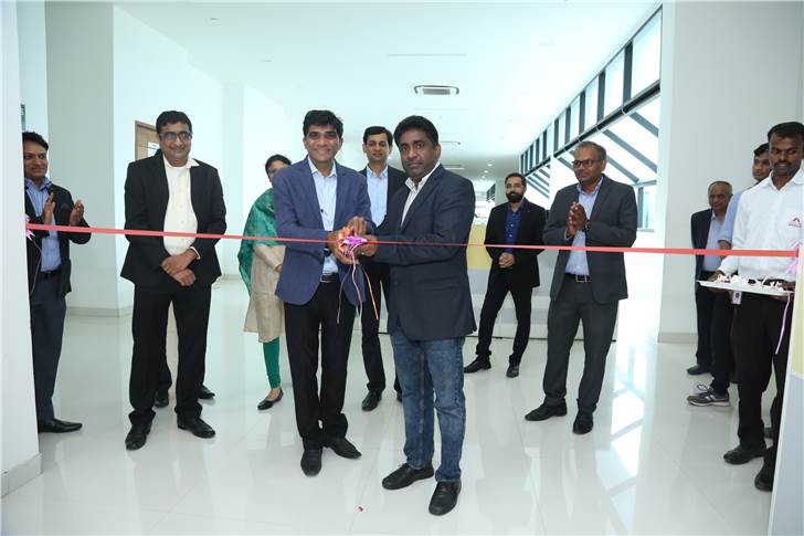 The Centre of Excellence being inaugurated by Suresh D and Rafiq Somani; along with Jitendra Miraje, Vishwas Vaidya, Vinay Pawar and delegates from Ansys.