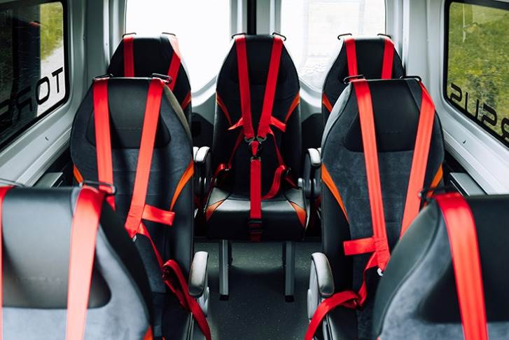 There are three-point seatbelts on fixed seats and the driver seat.