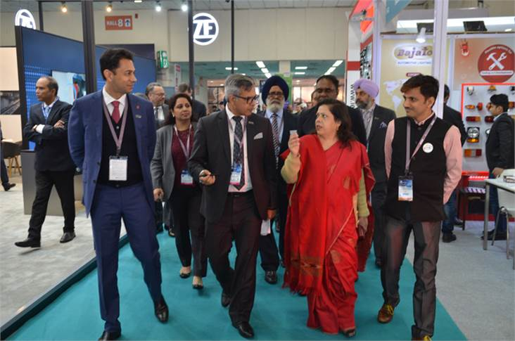 L-R: Deepak Jain, VP, ACMA; Vinnie Mehta, Director General, ACMA, and Rama Shankar Pandey, MD, Hella India Lighting, accompany Mrs Leena Nandan, Additional Secretary, MoRTH, on her rounds of the fair.