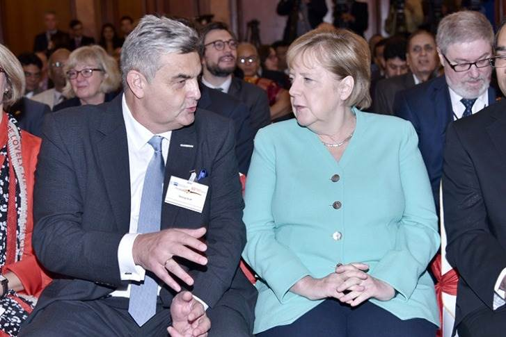 Interview of the Fortnight: Georg Graf, President of the Indo-German Chamber iof Commerce, seen here with Chancellor Angela Merkel on her visit to India in early November (Image: Freudenberg India)