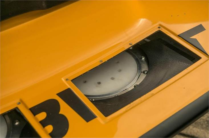 Front bodywork directs air around the front wheels and along the edge of the engine cowling to aid cooling but also houses the cooling tank, into which 25kg of ice is placed before each record run to cool air passing through the intercooler.