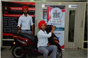 Automobile Engineering students of Chandigarh University, Khushwinder Pal Singh and Vikramjit Singh with their newly developed Biometeric security kit installed on a two-wheeler.