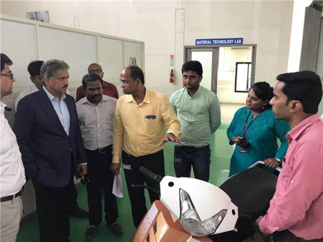 April 2017 file pic of Anand Mahindra, chairman, Mahindra Group, visiting the two-wheeler R&D facility in Pune. The then under-development e-scooter is seen in the foreground. (Anand Mahindra/Twitter)