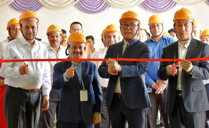 Arvind Goel, MD & CEO, Tata Autocomp Systems (extreme left) and Zhen Li, chairman, Guoxuan High-Tech, China (second from right), at the inauguration of the prototype manufacturing JV in Pune.