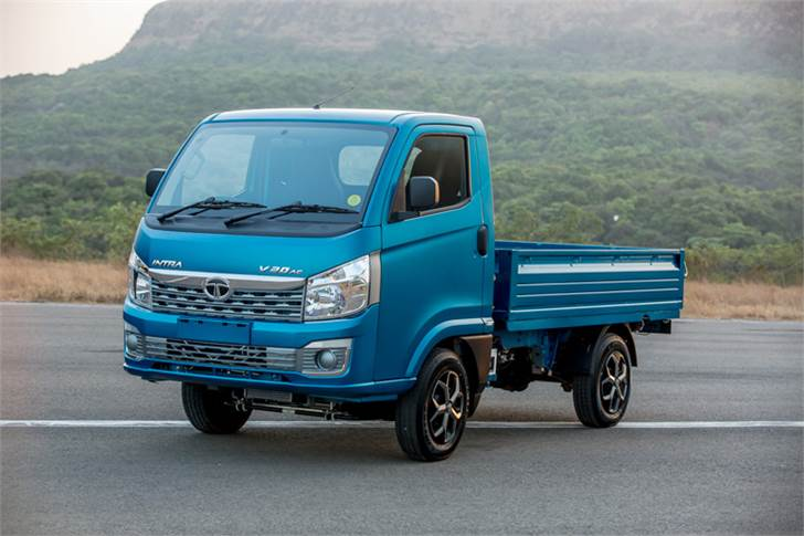 Tata Intra, shod with 14-inch radial tyres, claimed to have superior load-carrying capability for varied terrain. Front and rear rigid axle equipped with leaf springs (6 in front and 7 at the rear).