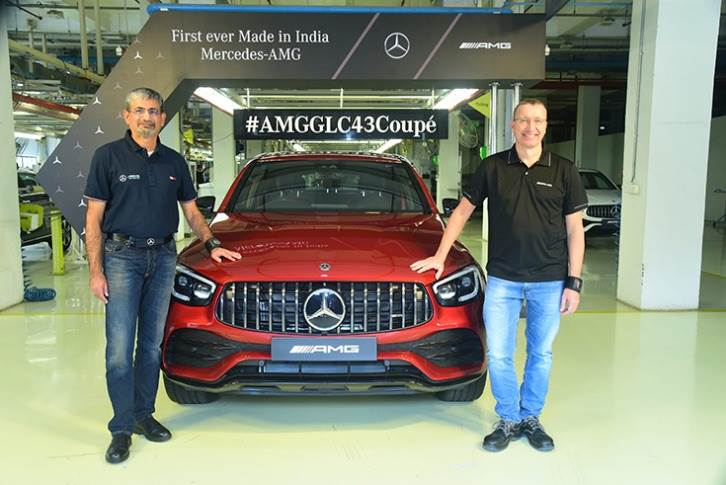 Piyush Arora, Executive Director, Mercedes-Benz India andMartin Schwenk, MD and CEO, Mercedes-Benz India with the made-in-India AMG GLC 43 Coupe.