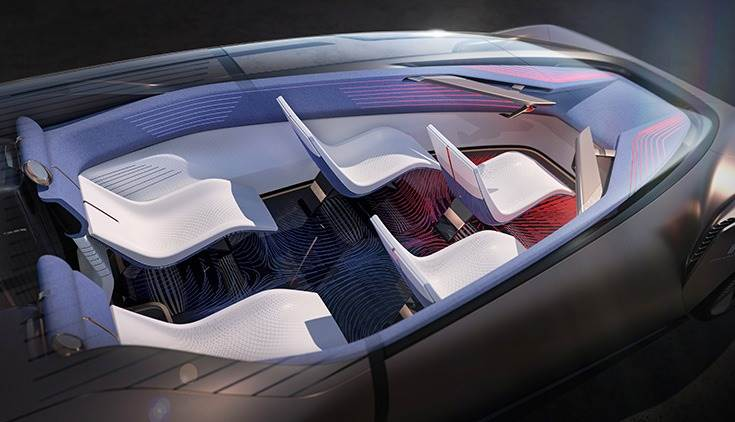 The occupants are positioned in a pentagon which creates the narrow cabin at the front and a wide body further back.