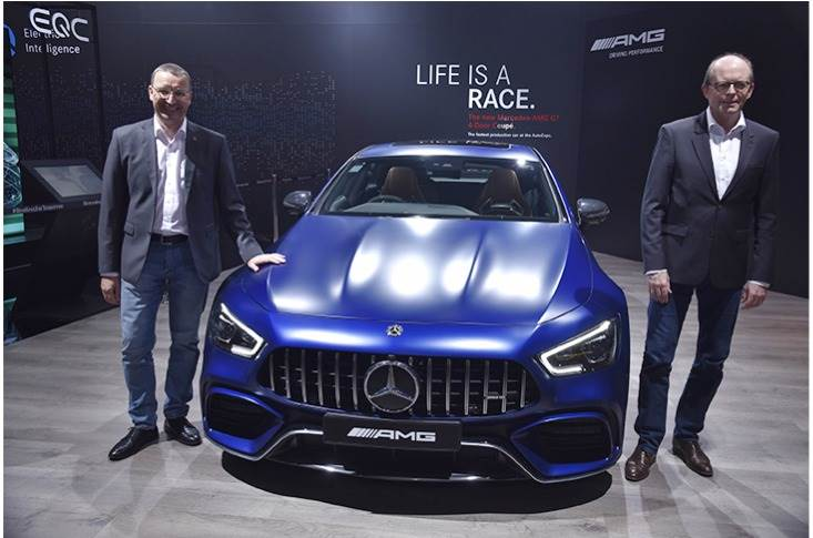 L-R: Martin Schwenk, MD and CEO, Mercedes-Benz India and Matthias Luehers, Head Region Overseas, Mercedes-Benz Cars with the New AMG GT 63 S 4 door coupe.