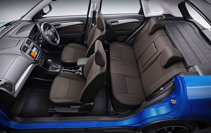Toyota Urban Cruiser gets dual-tone dark brown interiors inside a spacious cabin.