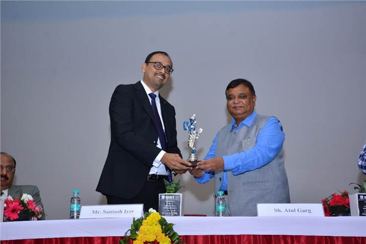 Santosh Iyer – vice president-customer services, retails training & corporate affairs, Mercedes-Benz India, being felicitated by Atul Garg, state minister of Uttar Pradesh.