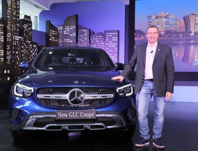 Martin Schwenk, Managing Director and CEO, Mercedes-Benz India with the New GLC Coupe launched today in Bangalore.