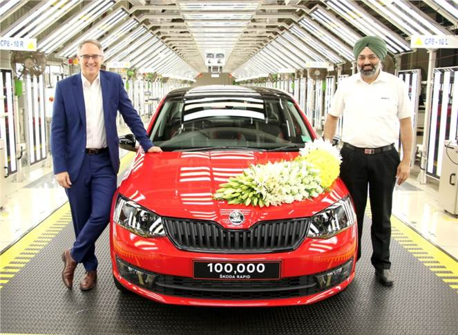 Skoda Auto India employees celebrating the production of 100,000th Rapid production.