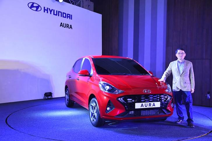 SS Kim, MD and CEO, Hyundai Motor India with the Aura compact sedan, which is to be officially launched next year.